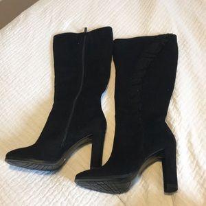 Ruffled boots never worn